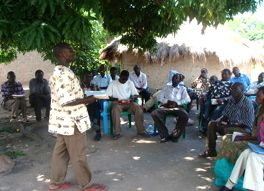 Africa_Man_Telling_Story_under_Tree_With_Open_Bible_2